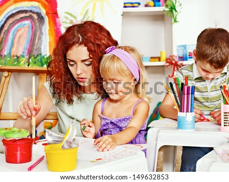 Child with mother painting . Child care. - stock photo