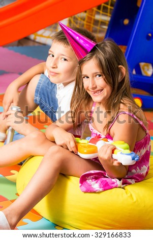 Child with music instruments - stock photo