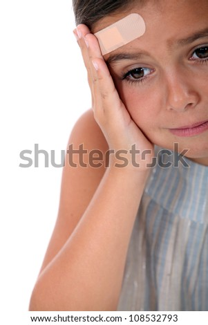 Child with pain in the forehead - stock photo