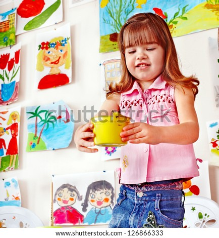 Child with paint  in art class . Preschool. - stock photo