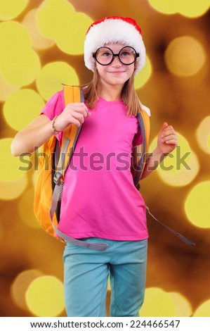 Child with Santa Claus red hat, backpack and glasses. Christmas, New Year celebration - stock photo