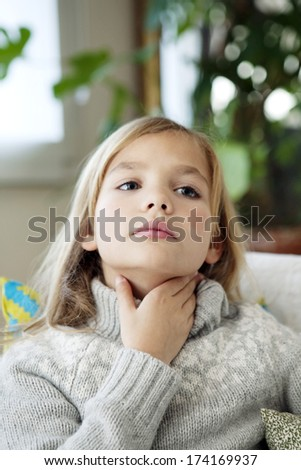 Child With Sore Throat - stock photo