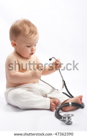 Child with stethoscope - stock photo