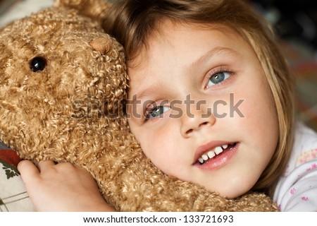 child with teddy bear - stock photo