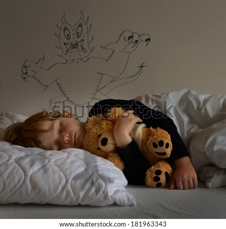 child with teddy bear, sleeping and having a nightmare - stock photo
