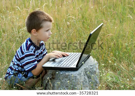 child working on laptop - stock photo