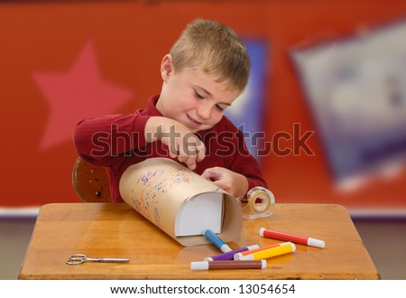 Child Wrapping a Homemade Gift - stock photo