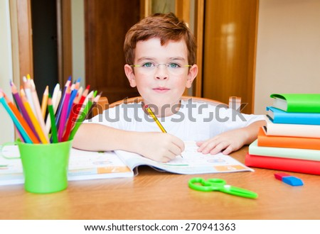 Child writing - stock photo