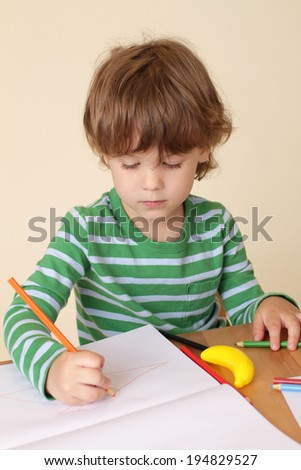 Child writing or drawing, learning, school or education concept - stock photo
