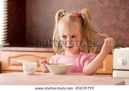 Child 3.5 years did not want to eat breakfast. - stock photo