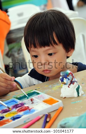 Child 2 years painting in preschool - stock photo