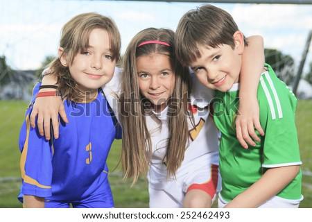 Childen play soccer on summer season - stock photo