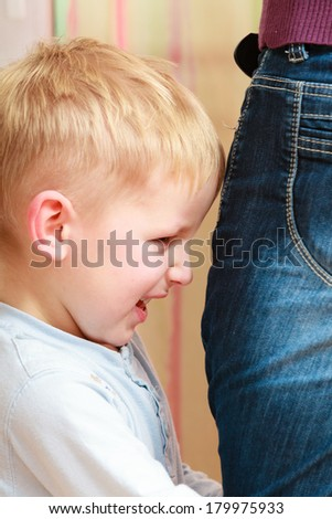 Childhood and motherhood. Unhappy angry boy kid son and his mother having conflict. Feelings and emotions. - stock photo