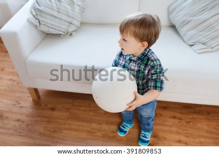 childhood and people concept - happy little baby boy with ball at home - stock photo