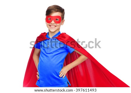 childhood, carnival costume and people concept - happy boy in red superhero cape and mask - stock photo