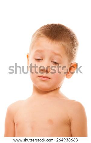 childhood concept - unhappy child expression. Sad sleepy little boy waking up - stock photo