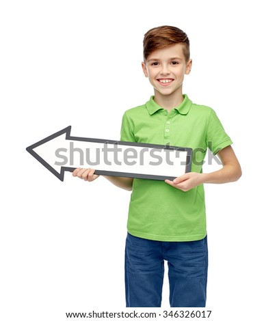 childhood, direction, advertisement and people concept - happy smiling boy in green polo t-shirt holding white blank arrow banner - stock photo