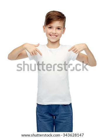 childhood, fashion, advertisement and people concept - happy boy in white t-shirt and jeans pointing finger to himself - stock photo