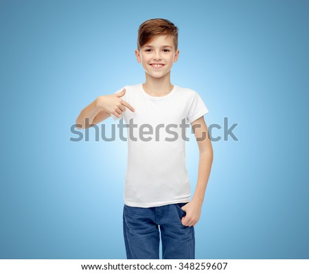 childhood, fashion, advertisement and people concept - happy boy in white t-shirt and jeans pointing finger to himself over blue background - stock photo