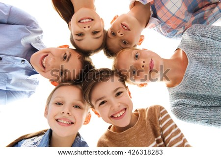 childhood, fashion, friendship and people concept - happy smiling children faces - stock photo