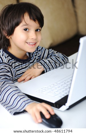 Childhood, laptop, learning and playing - stock photo