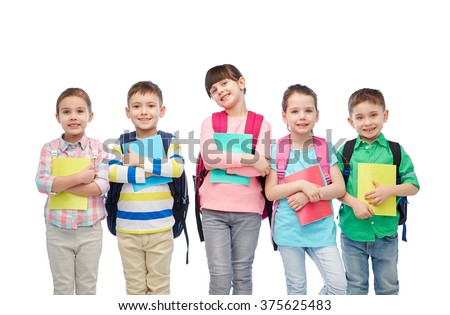 childhood, preschool education, learning and people concept - group of happy smiling little children with school bags and notebooks - stock photo