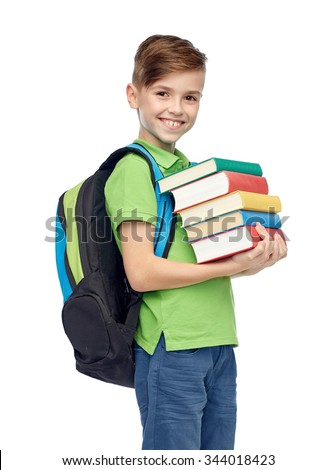 childhood, school, education and people concept - happy smiling student boy with school bag and books - stock photo