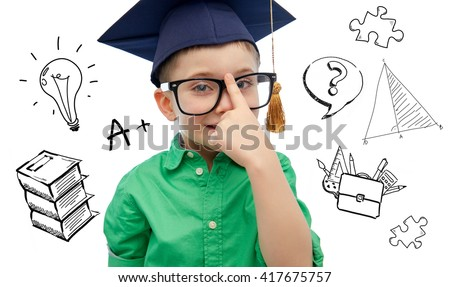 childhood, school, education, knowledge and people concept - happy boy in bachelor hat or mortarboard and eyeglasses over doodles - stock photo
