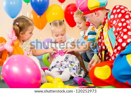 children and clown on birthday party - stock photo