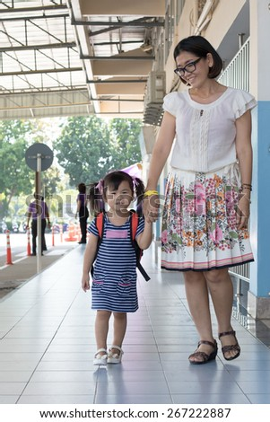 children and mother go to school first day use for education ,kid in kindergarten  - stock photo