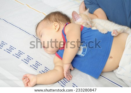 Children and pet sleeping and resting  daytime - stock photo