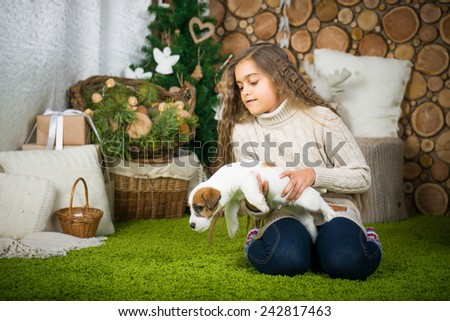 children and pets. The girl is sitting in the floor with the dog. Girl with dog. - stock photo