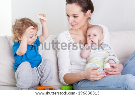 Children and their mother during free time - stock photo