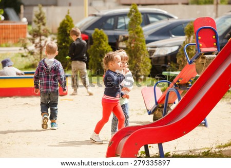 Children are playing at the playground outdoors - stock photo