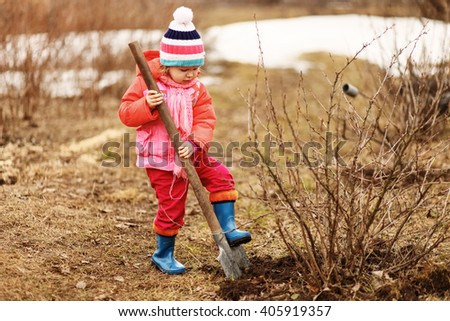 Children are the gardeners in the garden. - stock photo
