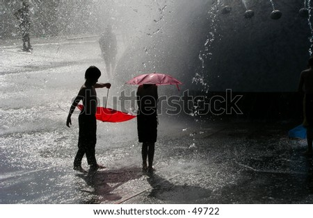Children at fountain - stock photo