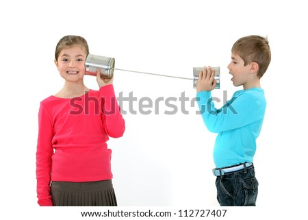 children at play with cans - stock photo