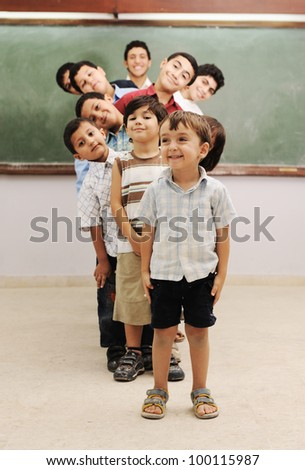 Children at school classroom - stock photo