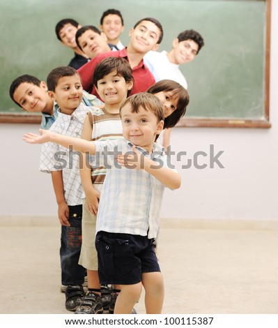 Children at school in row - stock photo