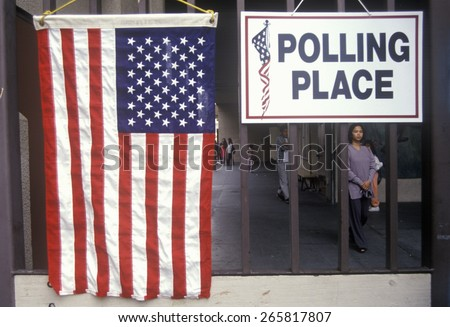 Children at the entrance to a polling place, CA - stock photo