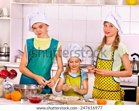 Children bake cookies at  kitchen. Children bake something from the dough - stock photo