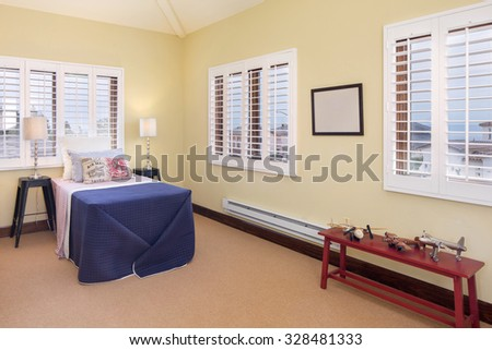 Children bedroom / kids room with light colorful decoration in beige. - stock photo