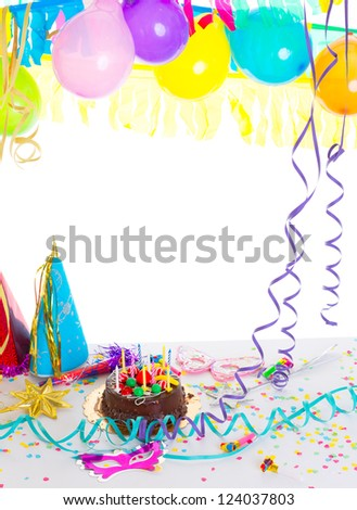 Children birthday party with chocolate cake confetti garland serpentine and balloons - stock photo