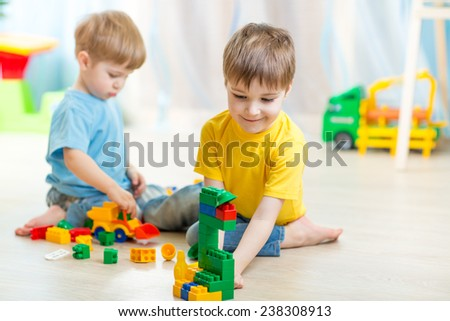 children boys playing in  playschool or at home - stock photo