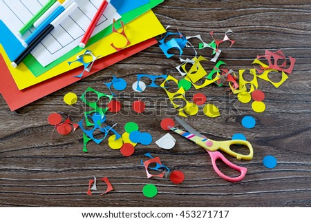 Children cardboard crafts - colored circles, cut. Scissors, glue, paper plates and colored circles. Background funny application. - stock photo