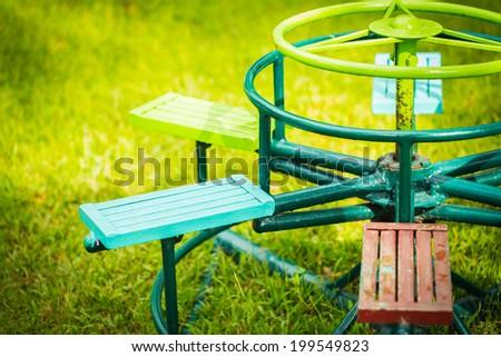 children carousel in playground - stock photo