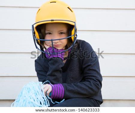 children cheerleading pom poms girl sad relaxed yellow baseball helmet - stock photo