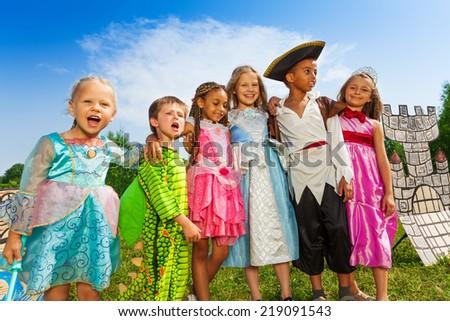 Children diversity in festival costumes standing - stock photo