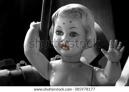 children doll with green blue eyes - scary stories - fear - a fairy tale - stock photo