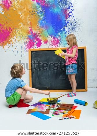 Children draw of paints on the floor - stock photo